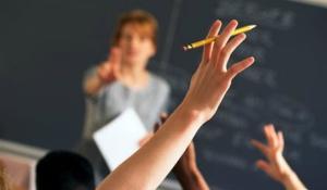 student_classroom_hand_raised_college_graduate